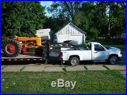 Minneapolis Moline UB pulling tractor